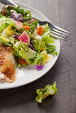 Top view of salad and chicken on dark wood. Italian salad with rotisserie chicken and white rice top view on dark wood Stock Photography