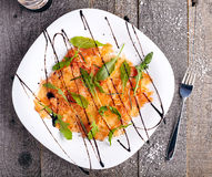 Top view of salmon carpaccio Royalty Free Stock Images