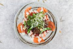 Top view of Salmon and shrimp salad with red oak, pea, crouton with mayonnaise topping with wild rocket. Top view of Salmon and shrimp salad with red oak, pea Stock Image