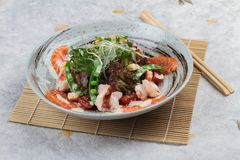 Top view of Salmon and shrimp salad with red oak, pea, crouton with mayonnaise topping with wild rocket. Top view of Salmon and shrimp salad with red oak, pea Royalty Free Stock Images