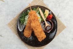 Top view of Salmon tempura sticks is deep fried salmon mixing with tempura flour served with sweet sauce. Royalty Free Stock Photo