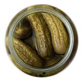Top view on salted cucumbers in glass jar Stock Photo