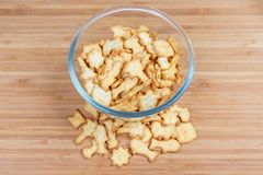 Top view of salty crackers various forms in glass bowl. Salty crackers in the forms associated with sea animals, seaside resort and marine recreation in glass royalty free stock image