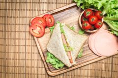 Top view of sandwiches and ham with tomatoes,Club sandwich with cheese and vegetable. A bread food in breakfast stock image