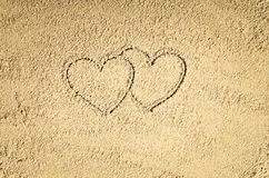 Top view of sandy beach drawing. Background with copy space. Top view of sandy beach with drawing in the sand or symbol. Background with copy space and visible Royalty Free Stock Image