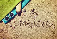 Top view of sandy beach. With summer accessories and love sing and Mallorca text Stock Images