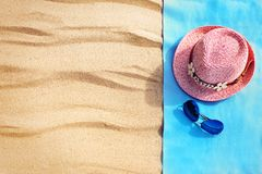 Top view of sandy beach with towel frame and summer accessories. Background with copy space and visible sand texture. Right border made of towel Stock Photos