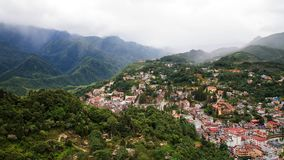 Top view of Sapa Town cityscape. Aerial top view Of Sapa Town cityscape with heavy mist in the valley, Vietnam. Landscape of city with Beautiful natural mountain Stock Photography