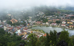 Top view of Sapa, Vietnam. Aerial view of clusters of buildings nestled in the green valley of Sapa, Vietnam Stock Photo