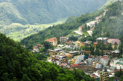 Top view of Sapa, Vietnam. Aerial view of clusters of buildings nestled in the green valley of Sapa, Vietnam Royalty Free Stock Photo