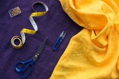 top view of scissors, measuring tape and box with pins over royalty free stock image