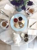 Top view of scones with milk and hot tea,tea break time with dessert on marble table stock photos