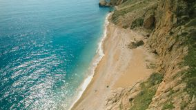 Top view of the sea and canyon with plants. Shot. Top view of the beautiful beach in mountains. Amazing sunny day stock photography