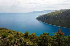 Top view of the sea strait or bay without boats and people from restaurant Vidicovac. Quiet, calm. Croatia, Plomin Royalty Free Stock Photo