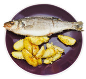 Top view of seabass and fried potatoes in plate Royalty Free Stock Images