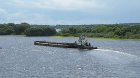 Empty barge on river on summer warm day. Top view of seascape - empty barge without cargo float along the river in summer sunny day stock video footage