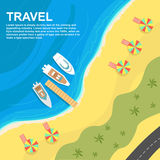 Top view of seashore with umbrellas, deck chairs and boats Royalty Free Stock Photo