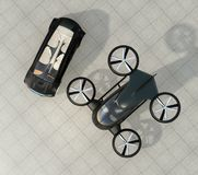 Top view of self-driving car and passenger drone parking on the ground. 3D rendering image Royalty Free Stock Photo