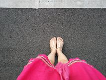 Top View Selfie of Nude Sandals on Gray Concrete. Copy Space, Beautiful Woman Wearing Pink Skirt or Dress and Shoes and Shoes Hips. Ter on Street Background royalty free stock image