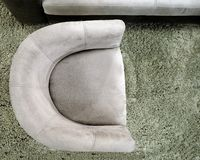 Top view of a semicircular gray armchair on a green  gray  carpet.  royalty free stock photography
