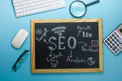 Top view of SEO Search Engine Optimization on black board on blu Stock Photos