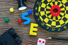 Top view of SEO search engine optimization website promotion c. Oncept with pencil, dart, lamp and binoculars in flat lay stock photos