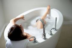 Top view of a serene mature woman in bathtub Stock Image
