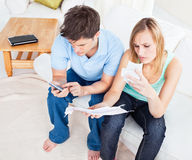 Top view of a serious couple calculating bills Stock Images