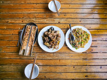 Top view of served chinese dinner in rustic eatery. Travel to China - top view of served local chinese dinner in rustic eatery in area Dazhai Longsheng Rice Royalty Free Stock Images