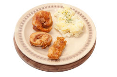 Top view of served fried fish with potato salad Royalty Free Stock Photos
