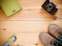 Top view set: camera, boots, sunglasses, copyspace Royalty Free Stock Image