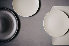Top view of set ceramic dishes brown and milky white colored, on gray background stock photo