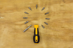 Top view of set head screw driver. Top view of screw driver on wood background Stock Photography
