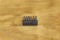 Top view of set head screw driver. On wood background Stock Photos
