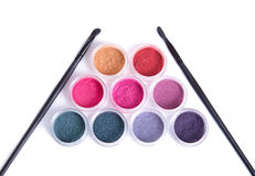 Top view of set of mineral eye shadows and makeup brushes Royalty Free Stock Photo