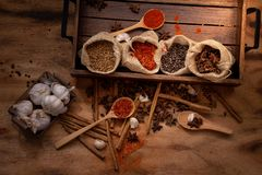 Top view set of spices and herbs on wooden tray royalty free stock photos