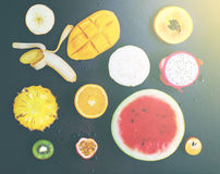 Top View Set Tropical Cut Fruits Black Background Stock Images