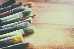 Top view of set of used paint brushes over blackboard background Stock Images