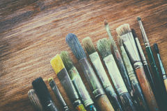 Top view of set of used paint brushes over blackboard background Royalty Free Stock Image