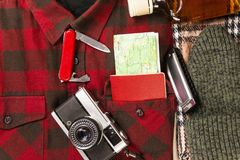 Top view of set of warm clothing and accessories for going on winter holiday in nature Royalty Free Stock Image
