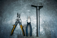 Top view of set working tools lying on metal table Stock Images