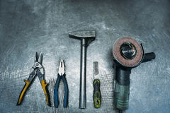 Top view of set working tools lying on metal table. Industry Stock Images