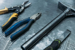 Top view of set working tools lying on metal table Royalty Free Stock Photos