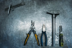 Top view of set working tools lying on metal table. Industry Royalty Free Stock Photography