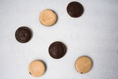 Top view of several chocolate covered snack cakes. On a white background stock images