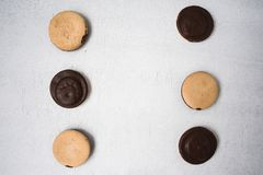 Top view of several chocolate covered snack cakes. On a white background royalty free stock photography
