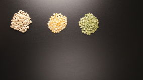 TOP VIEW: Several groat types fill on a black table stop motion stock footage