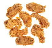 Top view of several roasted chicken wings cut out royalty free stock photos