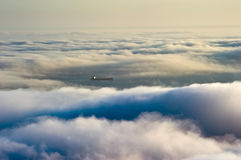 Top view of a ship sailing on the sea mist tightened. Stock Photos