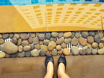 Top view shoes or foot at swimming pool border. Top view shoes or foot at the swimming pool border Royalty Free Stock Photos